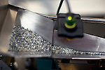GABORONE, BOTSWANA - SEPTEMBER 21: A machine sorts raw diamonds at the new Diamond Trading Company (DTC), the world's largest and most advanced diamond-sorting and valuing facility on September 21, 2009 in Gaborone, Botswana. It's a 50:50 joint venture between De Beers and the government or Botswana. This is a venture to bring back employment opportunities to Africa, the source of most diamonds in the world. Many of De Beers biggest customers are setting up diamond cutting, polishing, marketing for rough diamonds and it will lead to many new jobs created. (Photo by Per-Anders Pettersson)...