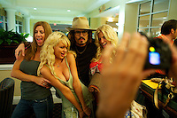 Jennifer Aniston, Paris Hilton, Johnny Depp and Jessica Simpson impersonators pose for tourists at The Sunburst Convention of Tribute Artists