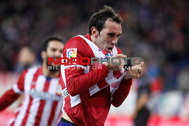 Atletico de Madrid¬¥s Diego Godin celebrates a goal during La Liga 2013-14 match at Vicente Calderon stadium, Madrid. December 21, 2013. Foto © nph / Victor Blanco)