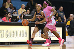 19 February 2015: Wake Forest's Mykia Jones (4) and North Carolina's Jamie Cherry (0). The University of North Carolina Tar Heels hosted the Wake Forest University Demon Deacons at Carmichael Arena in Chapel Hill, North Carolina in a 2014-15 NCAA Division I Women's Basketball game.