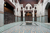 Bou Inania Madrasa, Meknes, Morocco, founded in 1350 by Abu Inan Faris, Marinid ruler, a fine example of Islamic architecture, pictured on December 20, 2009. The internal courtyard is tiled in ceramics with geomteric designs, and flanked by carved screens. Meknes, one of Morocco's Imperial cities, was redeveloped under Sultan Ismail Moulay (1634-1727). It is a fortified city built from pise, or clay and straw, and was designed to be the political capital of Morocco, as opposed to Fez, the religious capital. Picture by Manuel Cohen