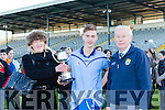 Inbhear Sceine Kenmare captain Colin Crowley receives the Eamon Martin memorial cup from his sister Mary Martin and Christy Killeen after they defeated Gaelcolaiste Ciarrai in the Corn Uí Mhairtin final in Fitzgerald Stadium on Wednesday