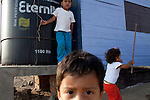 Children play on Thursday, Apr. 16, 2009 in Ventanilla, Peru.