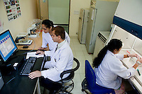 Doctors at work in the laboratory where the new GeneXpert diagnostic system (left) is installed at the Lala Ram Swawrup (LRS) Institute of Tuberculosis and Respiratory Diseases in New Delhi, India on 24th March 2011, World TB Day.