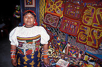 Young Kuna Indian woman from the San Blas Islands selling her molas and other handicrafts in Panama City