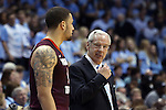 18 January 2015: UNC head coach Roy Williams (right) talks with Virginia Tech's Malik Muller (GER) (left) during an official timeout. The University of North Carolina Tar Heels played the Virginia Tech University Hokies in an NCAA Division I Men's basketball game at the Dean E. Smith Center in Chapel Hill, North Carolina. UNC won the game 68-53.