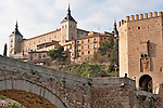 The Puente de Alcantara that crosses the Tagus River and leads to the old city gate into Toledo, Spain