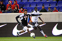 Andrew Farrell (5) of the Louisville Cardinals and Mamadou Doudou Diouf (23) of the Connecticut Huskies. Connecticut defeated Louisville 1-0 during the first semifinal match of the Big East Men's Soccer Championships at Red Bull Arena in Harrison, NJ, on November 11, 2011.