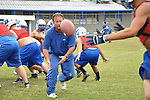 Head coach Mike Holcomb actively participates in Bobcat practices. Here, he tosses a ball on Wednesday, Oct. 12, 2011, in Jackson, Ky. | Photo by Taylor Moak