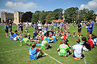 Dan Frost and Tom Dunn of Bath Rugby run the passing clinic. Bath Rugby Family Festival of Rugby, on August 8, 2015 at the Recreation Ground in Bath, England. Photo by: Patrick Khachfe / Onside Images