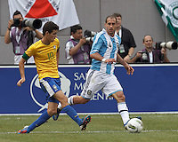 Brazil midfielder Oscar (10) centers the ball as Argentina defender Pablo Zabaleta (4) defends. In an international friendly (Clash of Titans), Argentina defeated Brazil, 4-3, at MetLife Stadium on June 9, 2012.