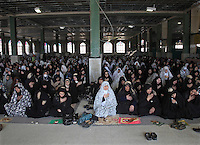 Women praying in a mosque on the Day of Ashura. Shia Muslims all over the world mourn the slaying of Imam Hussain, grandson of the Prophet Mohammed, during the first month of the Islamic calendar, called Muharram.