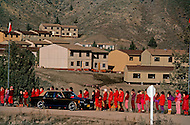 Wasco, Oregon, February 1984: Disciples of Bhagwan Rajneesh, wait in line along the roads of Rajneeshpuram to greet him during  his daily trip through the community in his Rolls-Roys. Bhawan Rajneesh (now known as Osho) possessed more than 20 Rolls-Royce cars and never used the same car two days in a row. Rajneeshpuram, was an intentional community in Wasco County, Oregon, briefly incorporated as a city in the 1980s, which was populated with followers of the spiritual teacher Osho, then known as Bhagwan Shree Rajneesh. The community was developed by turning a ranch from an empty rural property into a city complete with typical urban infrastructure, with population of about 7000 followers.