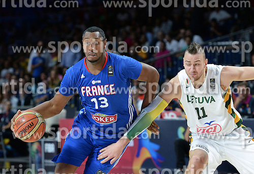 Boris Diaw of France vs Donatas Motiejunas of Lithuania during the 2014 FIBA World Basketball Championship Third Place match between France and Lithuania at the Palacio de los Deportes, on September 13, 2014 in Madrid, Spain. Photo by Tom Luksys  / Sportida.com <br /> ONLY FOR Slovenia, France