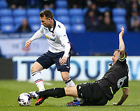 Bolton Wanderers' Adam Le Fondre is tackled by Bury's Antony Kay<br /> <br /> Photographer Alex Dodd/CameraSport<br /> <br /> The EFL Sky Bet League One - Bolton Wanderers v Bury - Tuesday 18th April 2017 - Macron Stadium - Bolton<br /> <br /> World Copyright &copy; 2017 CameraSport. All rights reserved. 43 Linden Ave. Countesthorpe. Leicester. England. LE8 5PG - Tel: +44 (0) 116 277 4147 - admin@camerasport.com - www.camerasport.com