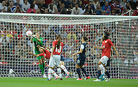 London, England - Thursday, August 9, 2012: The USA defeated Japan 2-1 to win the London 2012 Olympic gold medal at Wembley Arena. Hope Solo makes a save over Japan's Saki Kumagi..