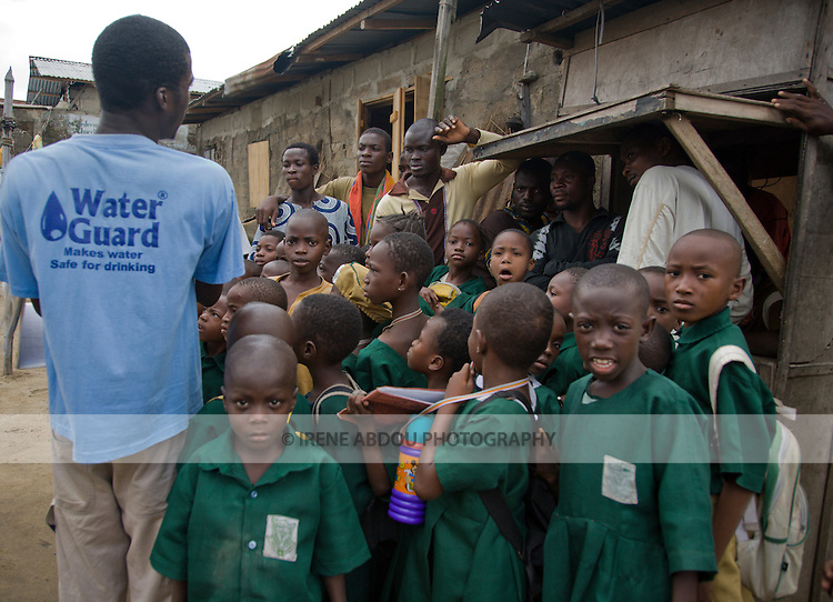 Volunteers from the community of Agboyi-Ketu in Lagos, Nigeria, conduct an education session about using Waterguard to make water safe to drink.  Waterguard, a chlorine product, is distributed by Nigeria's indigenous social marketing organization, the Society for Family Health.