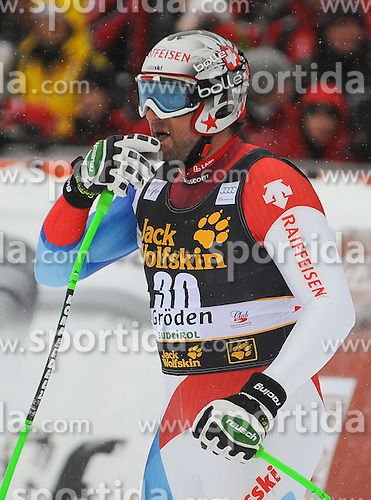 15.12.2012, Sasslong, Groeden, ITA, FIS Weltcup, Ski Alpin, Abfahrt, Herren, im Bild Silvan Zurbriggen (SUI) // Silvan Zurbriggen of Switzerland reacts after his Downhill run of the FIS Ski Alpine Worldcup at the Sasslong course, Groeden, Italy on 2012/12/15. EXPA Pictures © 2012, PhotoCredit: EXPA/ Erich Spiess