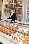 Saleswoman speaks with customers at Angelina, Rivoli Street, Rue de Rivoli, Paris, France, Europe