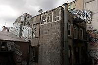 New York, NY - 3 August 2008 - Graffiti covered Chinatown tenements with satellite dish
