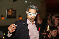 New York, NY - October 27, 2014: A guest wearing Asahi branded sunglasses at the International Chefs Congress afterparty, hosted by StarChefs. <br /> <br /> CREDIT: Clay Williams for StarChefs.<br /> <br /> &copy; Clay Williams / claywilliamsphoto.com