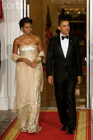 """24 Nov 2009, Washington, DC, USA --- """"U.S. President Barack Obama and first lady Michelle Obama await the arrival of India's Prime Minister Manmohan Singh and his wife Gursharan Kaur for a state dinner on the North Portico of the White House.                                """" --- Image by © Brooks Kraft/Corbis"""
