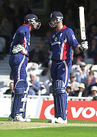 09/07/2002 - Tue.Sport - Cricket-  NatWest Series - Eng vs India Oval.England batting   Ronnie Irani and Andrew Flintoff  chat in the centre after Flintoff scores a half century (50)..