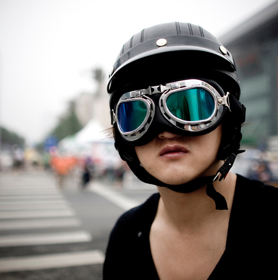 A motorcyclist wears a helmet and goggles as he rides in Beijing.