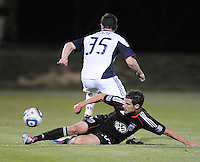 DC United midfielder Chris Pontius (13) slides to defend the play against New England Revolution midfielder Ryan Kinne (35)    The New England Revolution defeated DC United 3-2 in US Open Cup match , at the Maryland SoccerPlex, Tuesday  April 26, 2011.