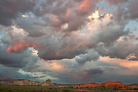 792800299 sandstone formations and clearing storm clouds at sunset along a backcountry byway in southern utah