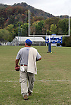 Assistant Coach Jon Collins finishes practice at Breathitt County High School on Wednesday Oct. 12, 2011 in Jackson, Ky. Collins works in the energy department for the schools and coaches two of his sons, Will Thomas and Jon Keith, who are on the team. Photo by Rachel Aretakis