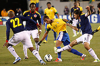 Brazilian player Lucas (C ) fights for the ball with Colombian players  during their friendly match at MetLife Stadium in East Rutherford New Jersey, November 14, 2012. Photo by Eduardo Munoz Alvarez / VIEWpress.