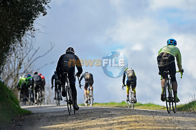 Brief sunshine during the wet day for the 5000 riders on the muddy gravel roads of Tuscany during the 2017 Strade Bianche Gran Fondo by Trek,  running 127km from Siena to Siena, Tuscany, Italy 5th March 2017.<br /> Picture: La Presse/Fabio Ferrari | Newsfile<br /> <br /> <br /> All photos usage must carry mandatory copyright credit (&copy; Newsfile | La Presse)