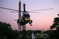 Marine One, with United States President Barack Obama aboard, flies near the Washington Monument comes in for a landing on the South Lawn of the White House in Washington, DC, USA, 09 October 2016. President Obama is returning from a weekend in Chicago.<br /> Credit: Shawn Thew / Pool via CNP /MediaPunch