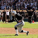 Oakland Raiders kicker Sebastian Janikowski (11) and punter Shane Lechler (9) celebrate game winning field goal on Sunday, September 28, 2003, in Oakland, California. The Raiders defeated the Chargers 34-31 in overtime.