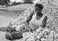 Stone crusher woman surrounding Gudi,Nassarawa State, Nigeria.