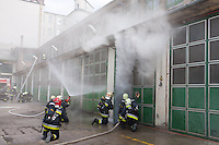 Firefighters practice putting out a chemical fire in one of their stations in Budapesst, Hungary. Wednesday, 29. April 2009. ATTILA VOLGYI