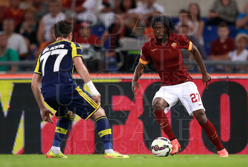 Calcio, amichevole Roma vs Fenerbahce. Roma, stadio Olimpico, 19 agosto 2014.<br /> Roma forward Gervinho, of Ivory Coast, is challenged by Fenerbahce midfielder Gokhan Gonul, left, during the friendly match between AS Roma and Fenerbahce at Rome's Olympic stadium, 19 August 2014.<br /> UPDATE IMAGES PRESS/Isabella Bonotto