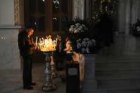 A man lights a candle at the Spaso-Preobrazhensky Cathedral, the main Russian Orthodox Church, on Christmas Eve in Odessa, Ukraine on January 6, 2016.  Orthodox Christians around the world celebrate Christmas on January 7.