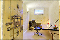BNPS.co.uk (01202 558833)<br /> Pic: FrancisAmbler/Fine&amp;Country/BNPS<br /> <br /> One of the old cells has been converted in to an office.<br /> <br /> Arrested development...<br /> <br /> A former magistrate's court and police station complete with original cells has been transformed into a quirky home - on the market for &pound;800,000.<br /> <br /> Although the building has had a makeover to a stylish home, the three cells for holding prisoners have been retained in their original form with one now serving as a study, another as a gym and the third as a utility room.<br /> <br /> The property was built in 1883 as part of Royston's police station and sergeant's house and also housed the magistrate's court for many years.