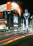 Sapporo's Susukino entertainment district at night.  The city plays hosts to the world famous Ice and Snow Festival. These are not traditional Frosty the Snowmen, but huge carved and chiseled Samurai Warriors, Buddhists gods, historical heroes of fairy tales and Walt Disney characters. Some stand as big as buildings. Chiseled out of tons of packed snow, the sculptures are the pride and job of the residents of Sapporo, Japan, who hosts the world famous Ice and Snow Sculpture Festival for five days in early February.Themes of the sculptures are picked from Kabuki stages, historical characters or fairy tales. (Jim Bryant Photo).....