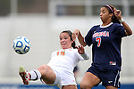 04 November 2012: Maryland's Erkia Nelson (15) clears the ball away from Virginia's Gloria Douglas (7). The University of Virginia Cavaliers defeated the University of Maryland Terrapins 4-0 at WakeMed Stadium in Cary, North Carolina in a 2012 NCAA Division I Women's Soccer and Atlantic Coast Conference Tournament Championship game.