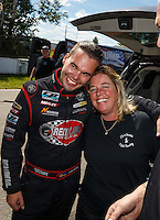 Aug 21, 2016; Brainerd, MN, USA; NHRA  top alcohol funny car driver Jonnie Lindberg (left) is congratulated by Annie Whiteley as he celebrates after winning the Lucas Oil Nationals at Brainerd International Raceway. Mandatory Credit: Mark J. Rebilas-USA TODAY Sports