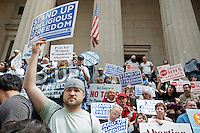 Members of various religious pro-life groups protest in front of Federal Hall in New York on Friday, March 23, 2012 against the implementation of President Barack Obama's healthcare mandate requiring most employers to provide healthcare coverage for contraception and sterilization as part of the federal healthcare overhaul. The groups rallied because they feel their religious freedom is impinged by the mandate. (© Richard B. Levine)