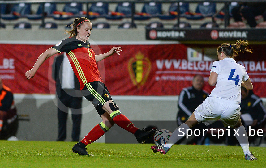 20160412 - LEUVEN ,  BELGIUM : Belgian Tine De Caigny (left) pictured in a duel with Estonian Pille Raadik (4) during the female soccer game between the Belgian Red Flames and Estonia , the fifth game in the qualification for the European Championship in The Netherlands 2017  , Tuesday 12 th April 2016 at Stadion Den Dreef  in Leuven , Belgium. PHOTO SPORTPIX.BE / DAVID CATRY