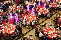 People eat and drink in the main dinning hall at The West Lake Restaurant. Able to seat up to 5,000 people at one sitting, The West Lake Restaurant is the biggest Chinese restaurant in the world. Each week its diners, who staff are taught are 'the bringers of good fortune', devour 700 chickens, 200 snakes, 1,200 kgs of pork and 1,000 kgs of chillis. Its 300 chefs cook in five kitchens and its staff total more than 1,000.It is fully booked most nights.