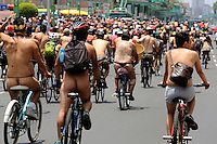 Mexico City, Mexico. 14th June 2014 - People attend the 9th. Nudist Ciclotón 2014. With this protest demanding respect for vehicle users, to understand that the only thing protecting cyclists in the city is its clothing.. Photo by Miguel Pantaleon/VIEWpress