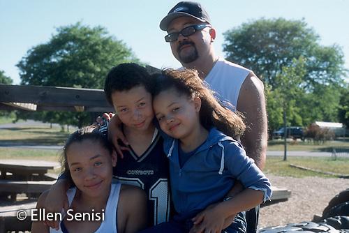 MR / Schenectady, NY. Rosendale Elementary School. Family portrait. MR only for girl right: 6, African American. MR: Mos4. ID: AJ-LC. © Ellen B. Senisi (Ellen B. Senisi)