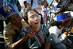 """Comforted by another demonstrator, a woman weeps outside a Phnom Penh court on December 14, 2012, after hearing that judges denied an appeal by Mam Sonando, a Cambodian radio journalist and human rights activist, who in October 2012 was sentenced to 20 years in prison for """"insurrection,"""" despite international calls for his release."""
