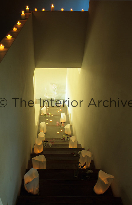 Candles illuminate the staircase while others in paper bags decorate the steps